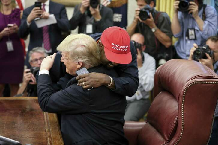 Rapper Kanye West hugs U.S. President Donald Trump during a meeting in the Oval Office of the White House on Oct. 11, 2018 in Washington, D.C.
