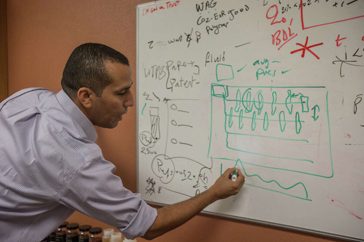 Ahmed Alzahabi, a member of the petroleum engineering faculty at University of Texas of the Permian Basin, works on a drilling model for his research on hydraulic fracturing.