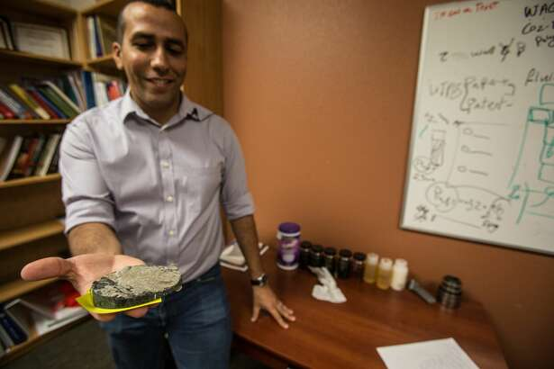 University of Texas of the Permian Basin Professor Ahmed Alzahabi holds a rock sample. He has been studying shale rock for the past four years.