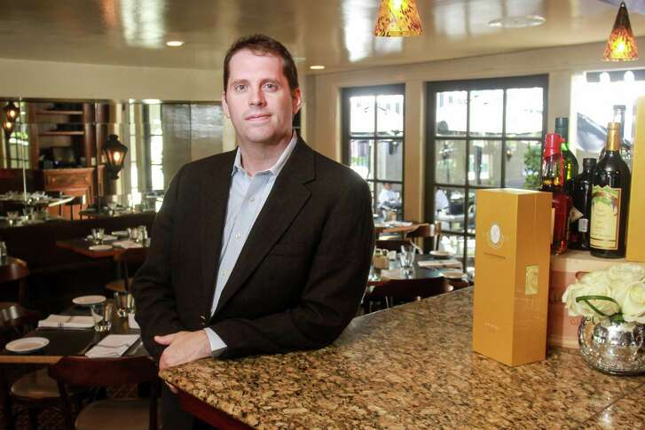Sean Beck, the wine director for Tracy Vaught and Hugo Ortega's restaurants, at Backstreet Cafe