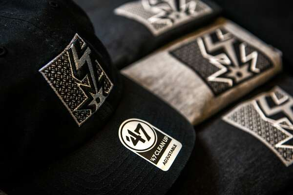 """Spurs Sports and Entertainment unveiled first looks at the exclusive """"Spurs Capsule Collection"""" on Monday which consists of five pieces. Fans can purchase the t-shirts, a hat and a sweatshirt, ranging from $29.99 and $58.99, starting at 10 a.m. CT on Tuesday."""