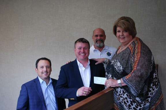 Pictured from left areJacob Esparza, David Dickey, Kenny Thompson and Cece Thompson. Members ofthe Wilchester Men's Club recently donated $6,000 to help retire meal-related debt incurred by Spring Branch ISD families who struggle to pay for school lunch.