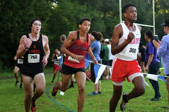 Bellaire's Koket Jimata (308), Atascocita's Nahim Abdallah, and Seven Lake's Zach Skillman (758) compete during the Varsity Boys race at the Andy Wells Invitational at Kingwood High School on Sept. 15, 2018.