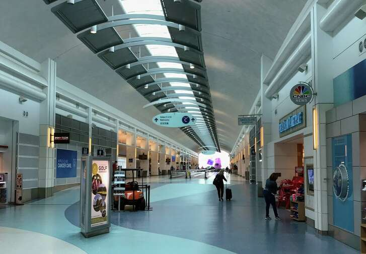 Jacksonville's bright, airy and blue tinged main concourse- Chris first spotted reverse ATMs when checking in for his flight