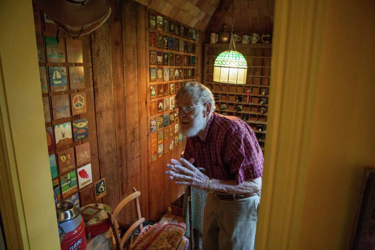 Henri Gadbois talks about a room in his home that contains wooden panels painted by artists who have visited him and his wife, Leila McConnell.