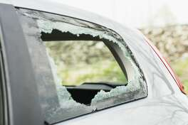 Stock photo, smashed window, car break-in