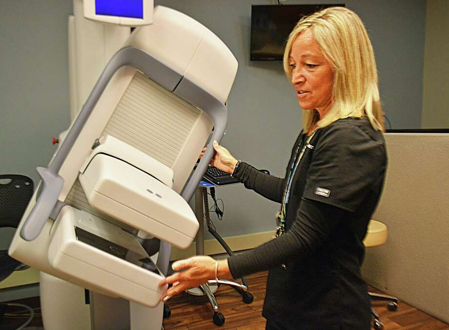 The Middlesex Hospital Cancer Center launched its comprehensive breast center during Breast Cancer Awareness Month. The facility, at 540 Saybrook Road in Middletown, is designed to help women who have an established high risk for breast cancer and those who may be at high risk due to family history or benign breast disease. Here, a radiologist demonstrates a dual-headed molecular breast imaging machine. Photo: Cassandra Day / Hearst Connecticut Media