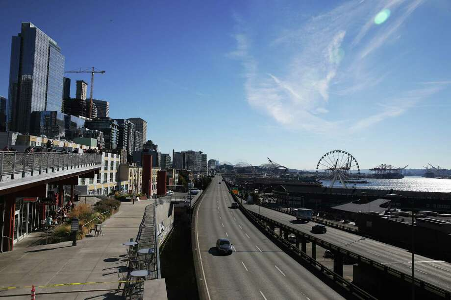 Construction continues on Alaskan Way and the viaduct, Monday, Oct. 15, 2018. Alaskan Way has been moved out from under the viaduct and almost all traffic has been redirected to the new, wider road west of the viaduct. The viaduct is slated to close permanently Jan. 11. Photo: GENNA MARTIN, SEATTLEPI.COM / SEATTLEPI.COM