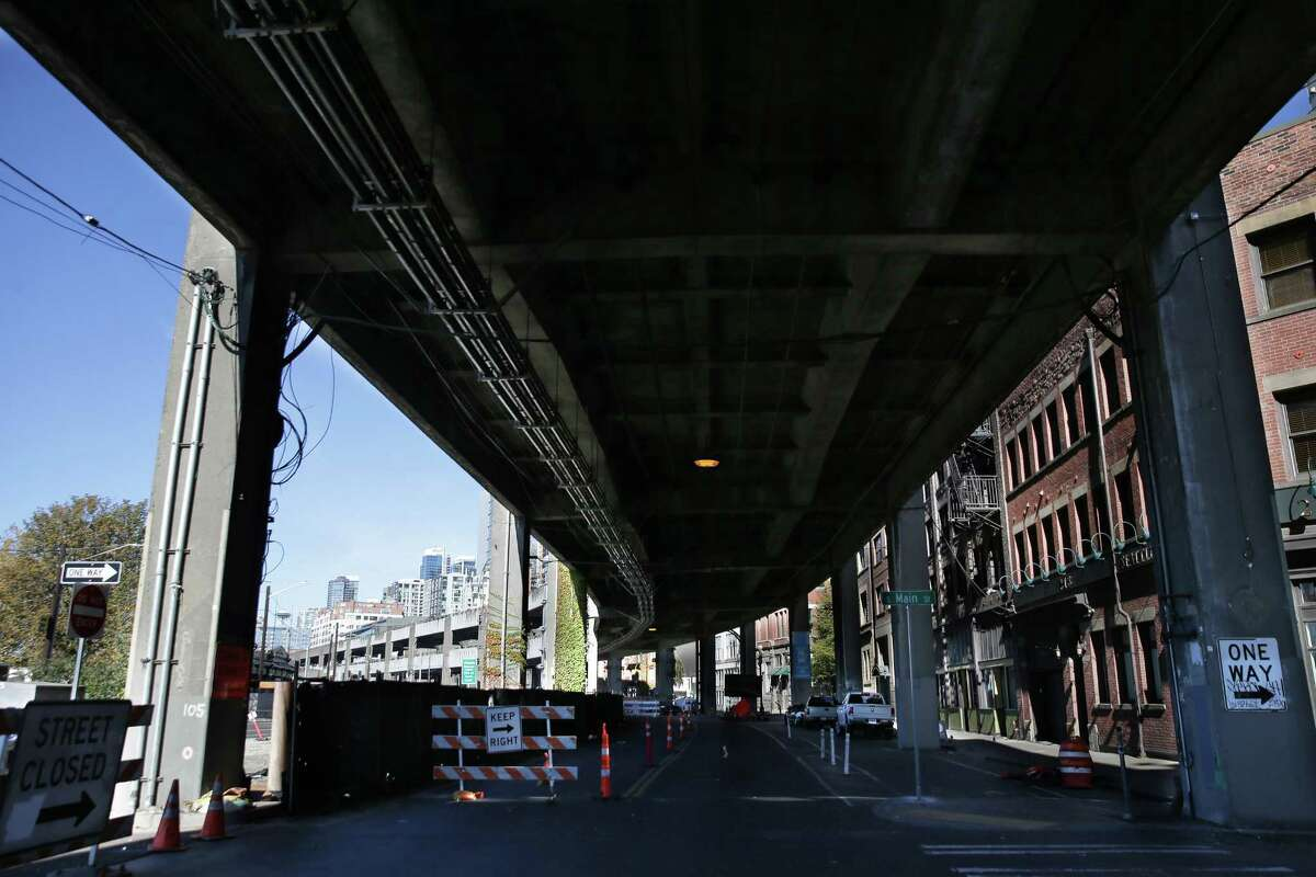 Construction continues on Alaskan Way and the viaduct, Monday, Oct. 15, 2018. Alaskan Way has been moved out from under the viaduct and almost all traffic has been redirected to the new, wider road west of the viaduct. The viaduct is slated to close permanently Jan. 11.