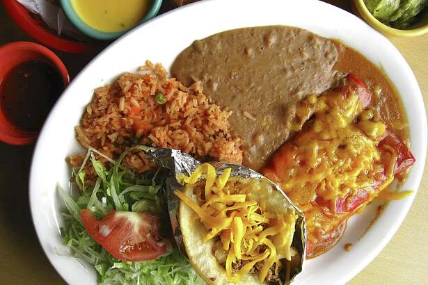 An enchilada and puffy taco plate with rice, beans and a side of guacamole from Plaza Guadalajara, a new Mexican restaurant on McCullough Avenue.
