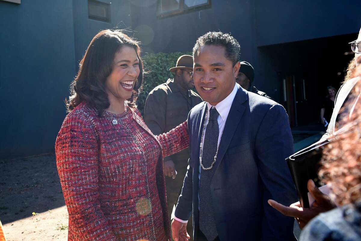 San Francisco Mayor London Breed, left, and Faauuga Moliga stand together following a ceremony swearing in Moliga as a new member of the San Francisco Board of Education, held at the June Jordan School for Equity in San Francisco, Calif., on Monday October 15th, 2018.