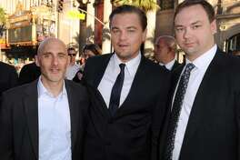 "LOS ANGELES, CA - JULY 13:  (L-R) President of Warner Bros. Pictures Group Jeff Robinov, actor Leonardo DiCaprio, and executive producer Thomas Tull arrive to premiere of Warner Bros. ""Inception"" at Grauman's Chinese Theatre on July 13, 2010 in Los Angeles, California.  (Photo by Kevin Winter/Getty Images) *** Local Caption *** Jeff Robinov;Leonardo DiCaprio;Thomas Tull"