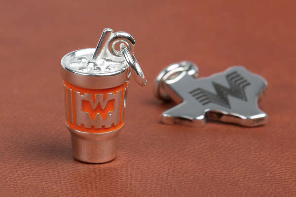 Whataburger and James Avery fans can show everyone that their cups runneth over with love for the two brands via a brand-new sterling silver charm. The Texas companies teamed up to create a one-of-a-kind collector's item, a tiny replica of the Whataburger cup, complete with hand-painted orange enamel.