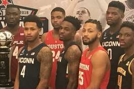 UConn's Jalen Adams, second from left, Tarin Smith, center, and Eric Cobb, second from right, pose for photos at AAC media day on Monday.
