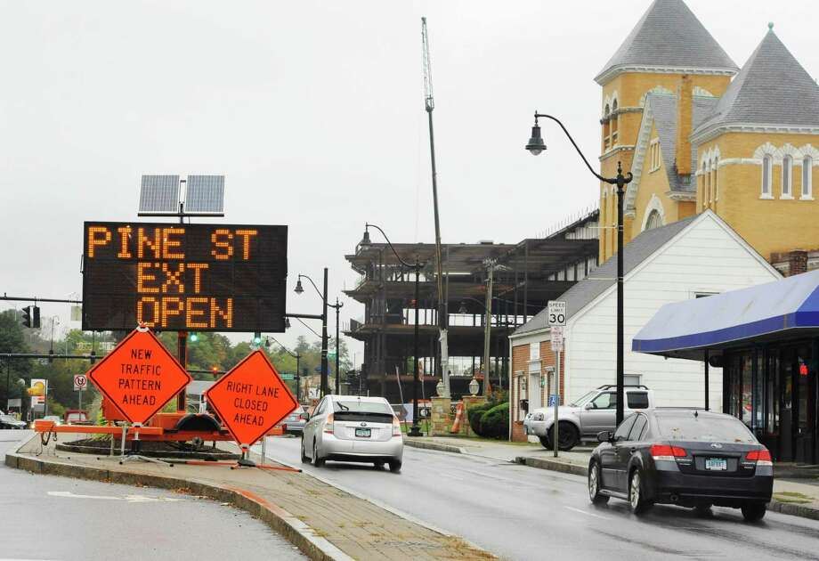 Traffic signs direct motorists on West Avenue in Norwalk, Conn. on Monday, October 15, 2018. The Norwalk Traffic Authority on Monday afternoon extended from Nov. 16, 2018, until Jan. 31, 2019 the temporary one-way traffic diversion plan on Pine Street Extension to allow construction to continue on the Bloomingdales portion of The SoNo Collection. Motorists will continue to enter the extension from West Avenue near Macedonia Church and return to West Avenue near ONeill's Pub & Restaurant. Photo: Cathy Zuraw / Hearst Connecticut Media / Norwalk Hour