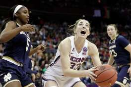 Connecticut's Katie Lou Samuelson (33) heads to the basket as Notre Dame's Jackie Young watches during the first half in the semifinals of the women's NCAA Final Four college basketball tournament, Friday, March 30, 2018, in Columbus, Ohio. (AP Photo/Tony Dejak)