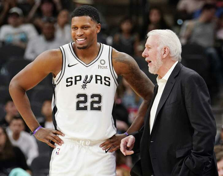 San Antonio Spurs head coach Gregg Popovich, right, talks to forward Rudy Gay during the second half of an NBA preseason basketball game against the Houston Rockets, Sunday, Oct. 7, 2018, in San Antonio. (AP Photo/Darren Abate)