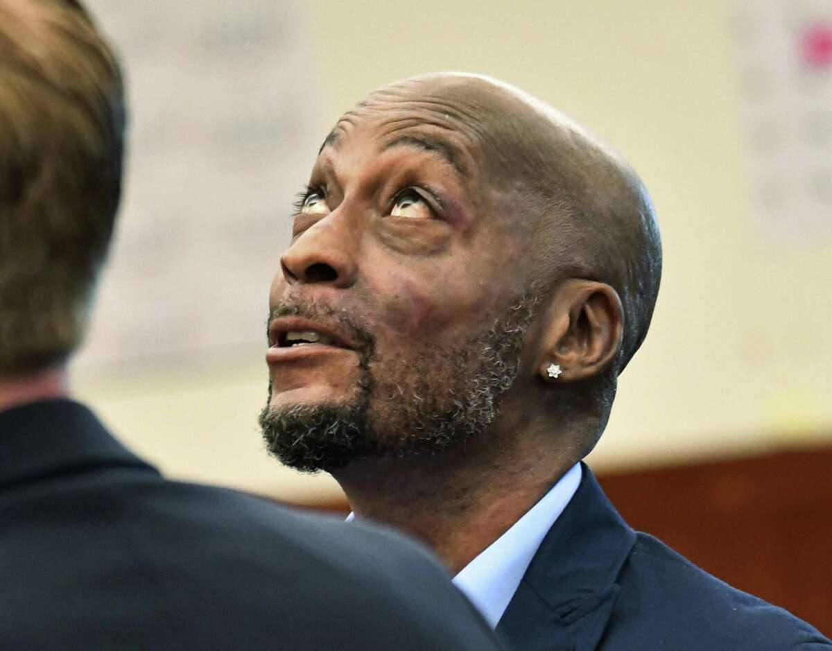 In this July, 9, 2018, file photo, plaintiff DeWayne Johnson looks up during a brief break as the Monsanto trial in San Francisco. Monsanto is being accused of hiding the dangers of its popular Roundup products. A San Francisco jury on Friday, Aug. 10, 2018, ordered agribusiness giant Monsanto to pay $289 million to a former school groundskeeper dying of cancer, saying the company's popular Roundup weed killer contributed to his disease. The lawsuit brought by Johnson was the first to go to trial among hundreds filed in state and federal courts saying Roundup causes non-Hodgkin's lymphoma, which Monsanto denies.