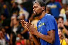 Golden State Warriors forward Kevin Durant (35) on the court for warm up before an NBA preseason game against the Los Angeles Lakers at the SAP Center on Friday, Oct. 12, 2018, in San Jose, Calif.
