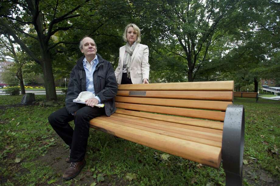 Strawberry Hill Neighborhood Association members Dave Avery and Dianne Walker pose for a photo on the bench at Carpinella Park dedicated to Karina Tinajero-Arreguin, the Stamford High School student killed by a car on Strawberry Hill Ave., in Stamford, Conn. on Monday, Oct. 15, 2018. Photo: Michael Cummo / Hearst Connecticut Media / Stamford Advocate
