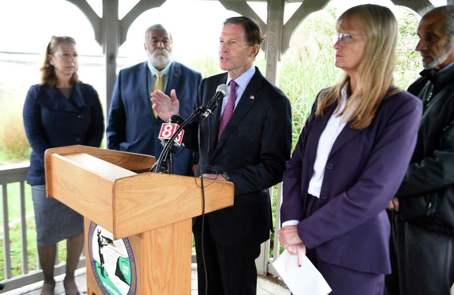 U.S. Sen. Richard Blumenthal, second from right, speaks about the recently authorized Water Resources Development Act, at a press conference behind the Savin Rock Conference Center in West Haven Monday. Photo: Arnold Gold / Hearst Connecticut Media / New Haven Register