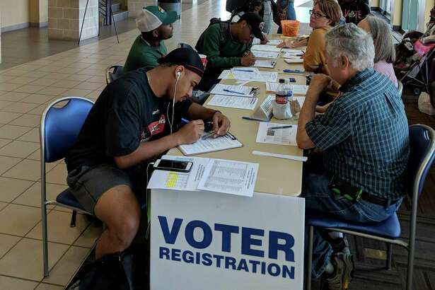 Prairie View A&M University students recently register to vote in the November election in Texas. A reader urges to use their voice by voting.