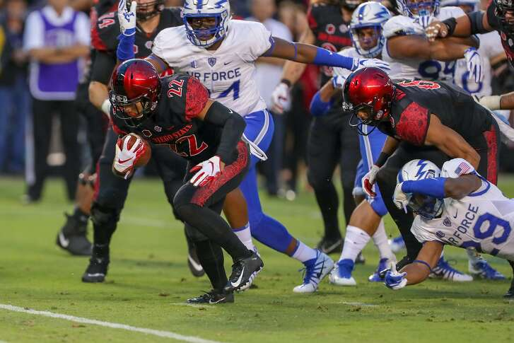 SAN DIEGO, CA - OCTOBER 12:  Chase Jasmin #22 of the San Diego State Aztecs runs with the ball scoring a touchdown in the 1st half against the Air Force Falcons at Qualcomm Stadium on October 12, 2018 in San Diego, California.  (Photo by Kent Horner/Getty Images)