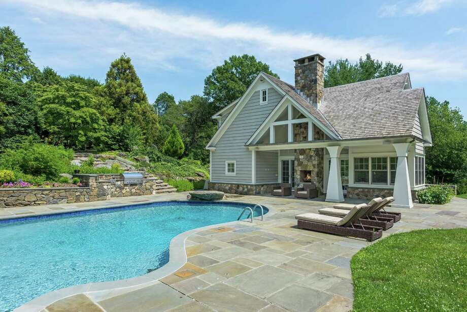 Listed for $6.45 million, 136 Parsonage Road is a 2015 custom-built colonial with five bedrooms, more than 7,900 square feet of living space, a long list of amenities — heated and cooled by way of an energy-efficient geothermal system. Photo: Daniel Milstein Photography / © 2017 Daniel Milstein Photography