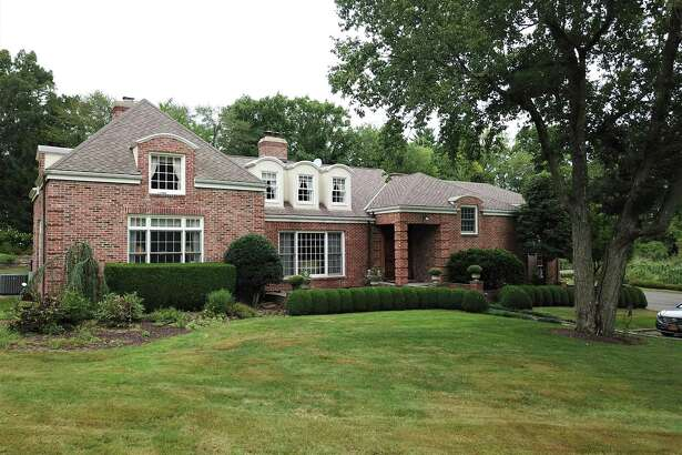 10 Dewart Road in Greenwich is a 5,075-square-foot brick colonial on 2.14 acres.