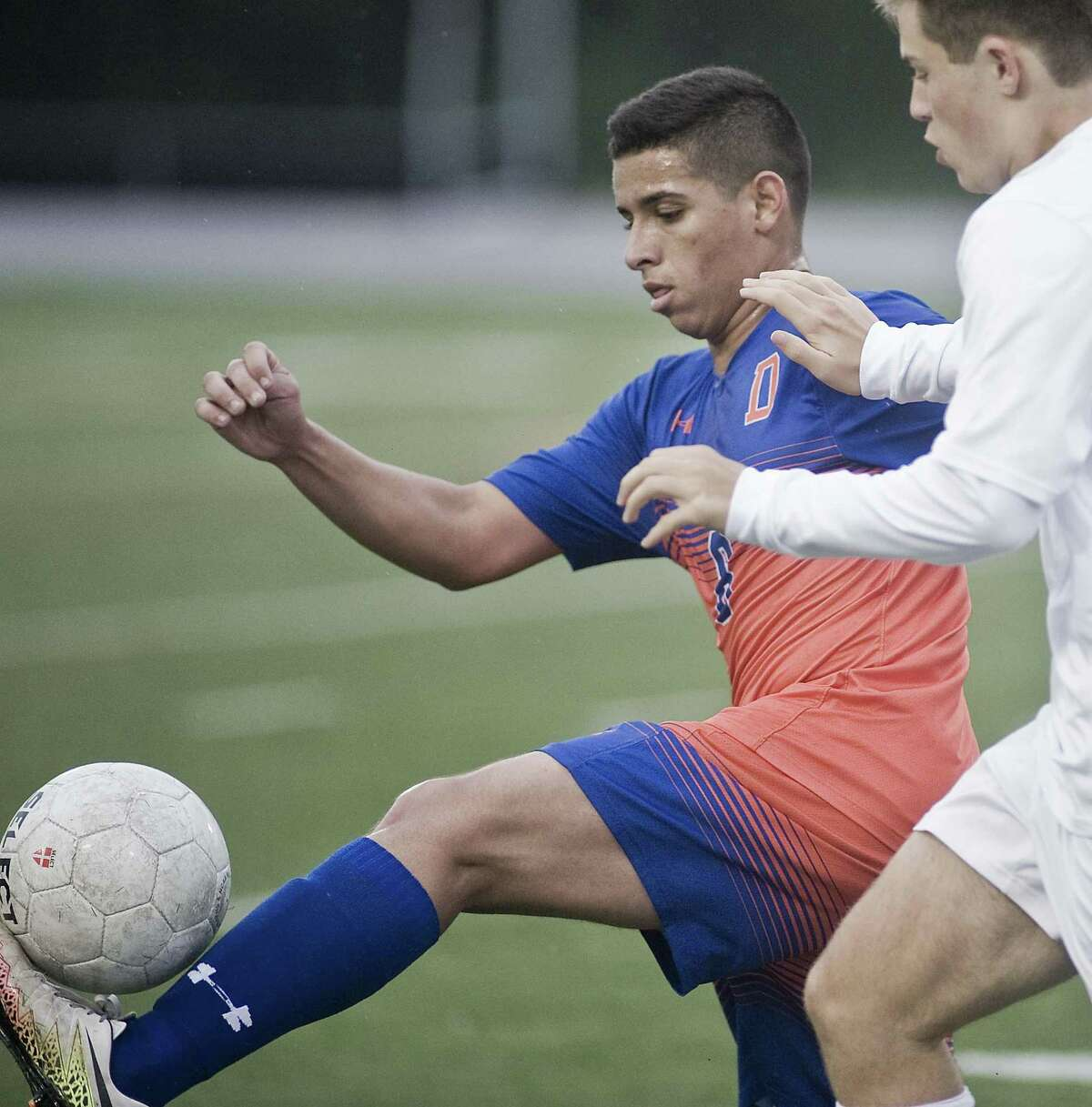 Danbury High School's Erik Costa gets a foot on the ball during a game against Wilton High School, played at Danbury. Monday, Oct. 15, 2018