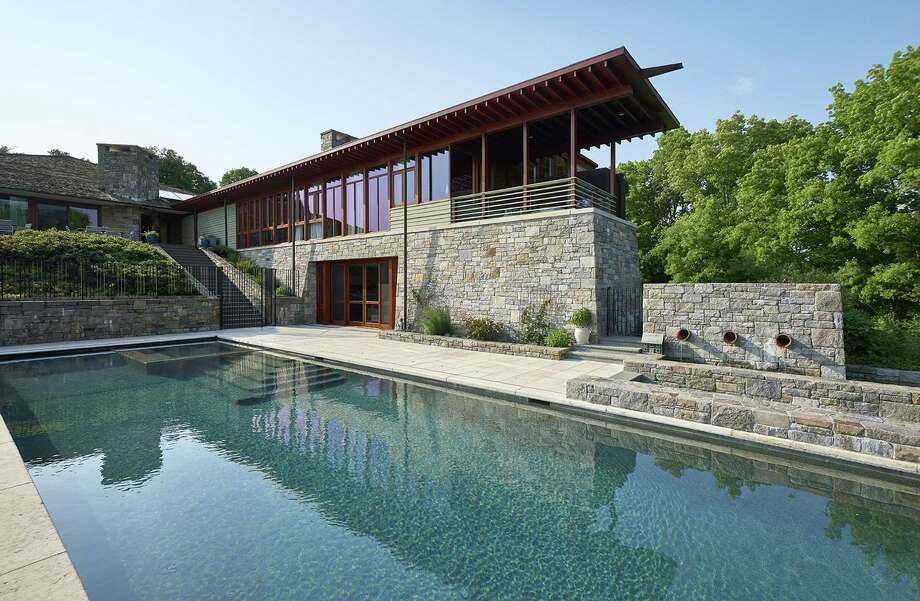 """The single-family contemporary at 121 Middlebrook Farm Road in Wilton is called the """"Lookout House,"""" which describes the high vantage point and views from the 4.92-acre lot. Photo: William Raveis Real Estate / Andy Romer Photography"""