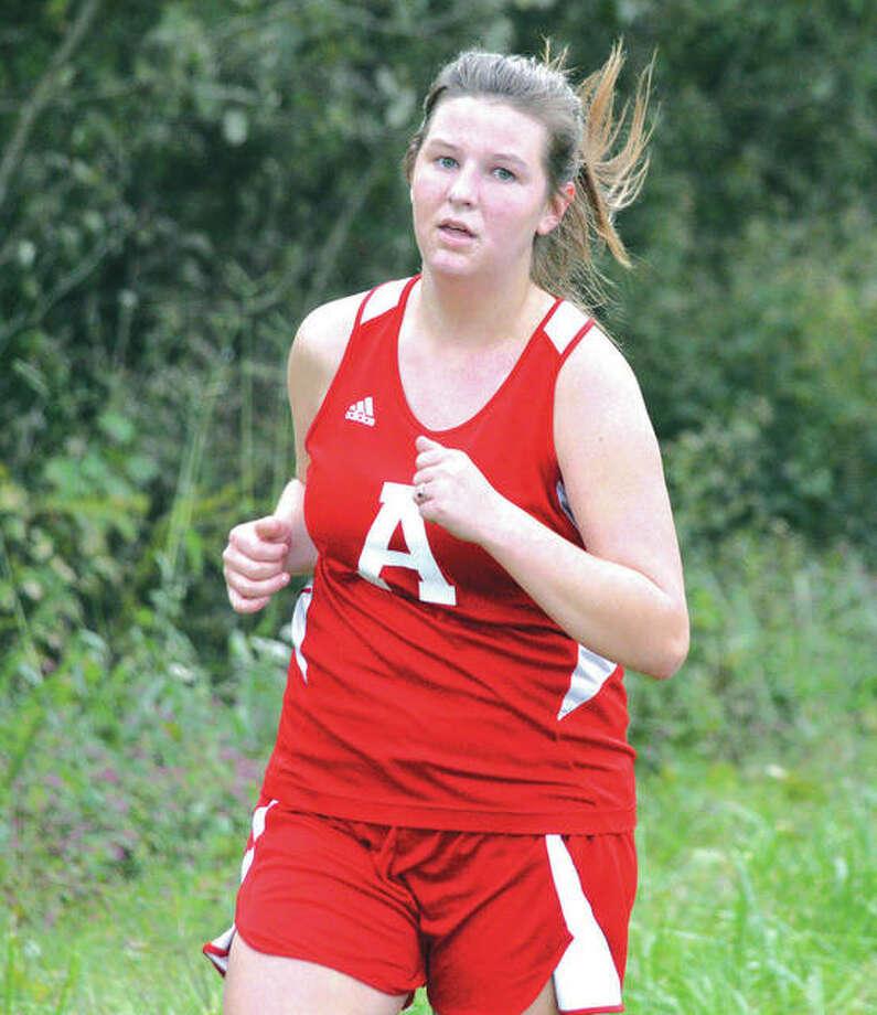 Alton's Megan Croxford runs during the Tiger Finale on Monday at SIUE in Edwardsville. Photo: Scott Marion / Hearst Illinois