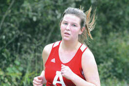 Alton's Megan Croxford runs during the Tiger Finale on Monday at SIUE in Edwardsville.