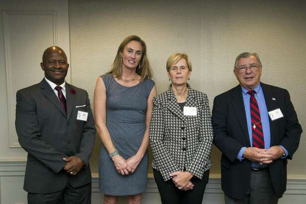 2018 Connecticut Sports Hall of Fame inductees, from left, Travis Simms of Norwalk, A.J. Mleczko Griswold of New Canaan, Claire Beth Tomasiewicz Nogay of Weston and John Kuczo of Stamford pose for a photo during the Fairfield County Sports Commision's Sports Night at the Stamford Marriott in downtown Stamford, Conn. on Monday, Oct. 15, 2018.