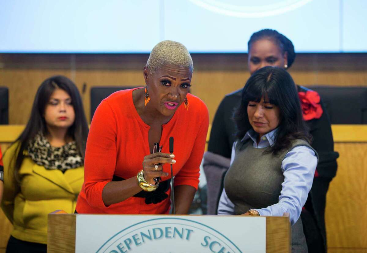 Houston Independent School District trustees Jolanda Jones and Diana Dávila end a press conference without taking questions at the Hattie Mae White Educational Support Center, Monday, Oct. 15, 2018 in Houston.