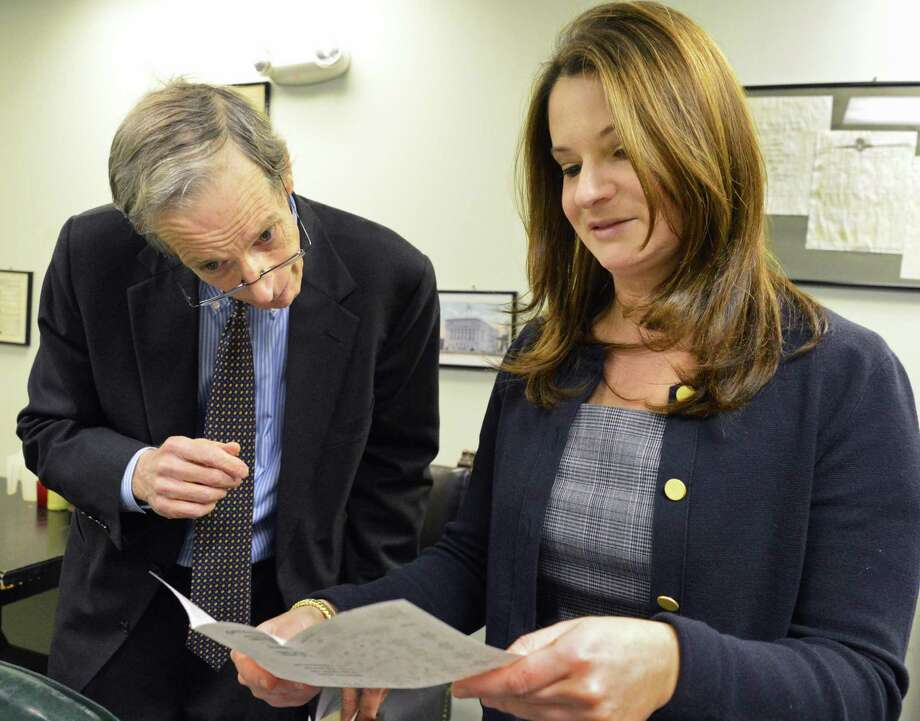 Albany County elections commissioners Matthew Clyne, left, and Rachel Bledi, seen here counting absentee ballots in January 2013, are being sued by Albany resident Clifton Dixon, who was knocked off the ballot for County Legislature last week. (John Carl D'Annibale / Times Union) ORG XMIT: MER2015072620472832 Photo: John Carl D'Annibale / 00020825A