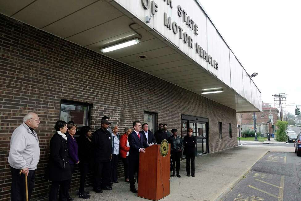 Albany County Legislature Chair Andrew Joyce, at podium, addresses those gathered for a press conference outside the New York State Department of Motor Vehicles office on South Pearl Street on Monday, Oct. 8, 2018, in Albany, N.Y. Elected officials and community leaders gathered to denounce statements by the Albany County Board of Elections Republican Elections Commissioner, Rachel Bledi, who said that the South End is a