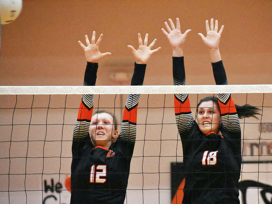 Edwardsville's Morgan Tulacro, left, and Corrine Timmermann go up for a block during the first game against Breese Mater Dei on Monday. Photo: Matt Kamp/Intelligencer