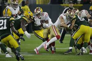 San Francisco 49ers running back Matt Breida (22) runs against the Green Bay Packers during the first half of an NFL football game Monday, Oct. 15, 2018, in Green Bay, Wis. (AP Photo/Mike Roemer)