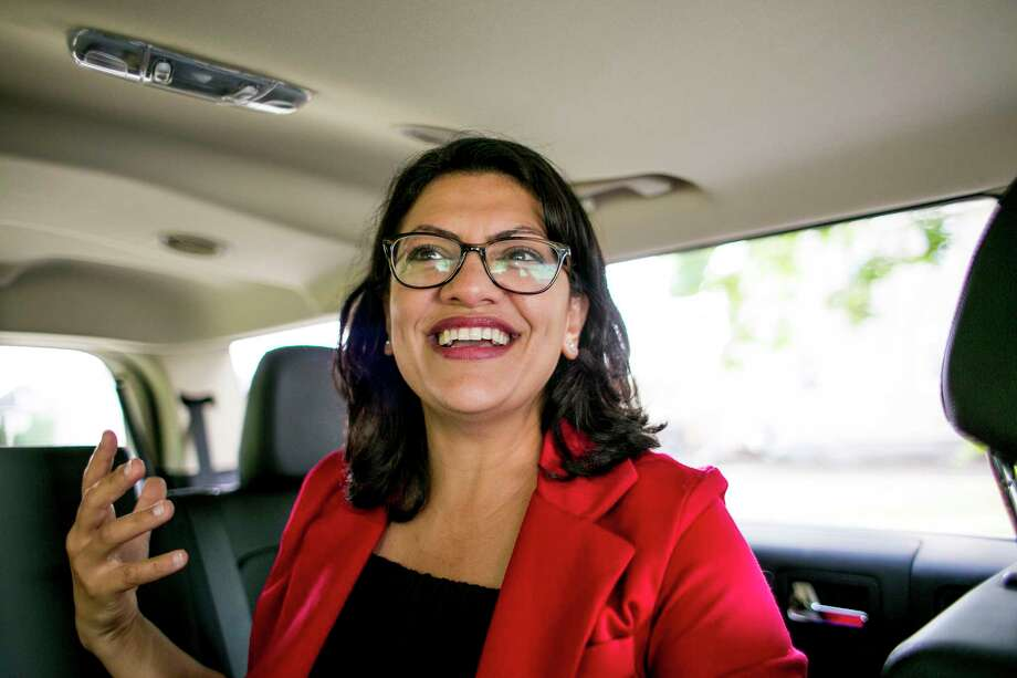 """FILE — Rashida Tlaib, a Palestinian-American Democrat poised to become the first Muslim woman elected to Congress, travels between events in Detroit, Aug. 10, 2018. Tlaib is among a new wave of Democrats who are testing the party's blanket support for Israel. """"No country, not one, should be able to get aid from the U.S. when they still promote that kind of injustice,"""" she said. (Anthony Lanzilote/The New York Times) Photo: ANTHONY LANZILOTE / NYTNS"""