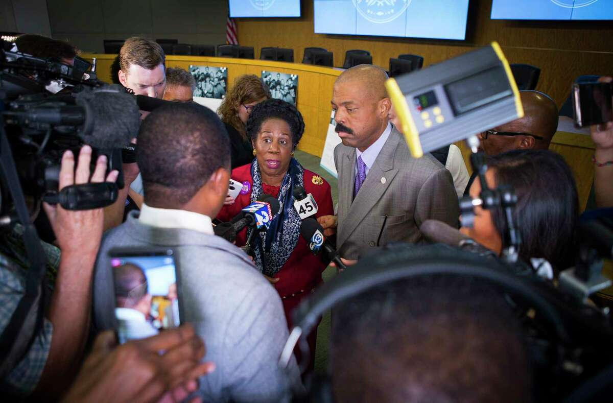 Congresswoman Sheila Jackson Lee and state Sen. Borris Miles talk to the media following a press conference at the Hattie Mae White Educational Support Center, Monday, Oct. 15, 2018 in Houston. Trustees apologized for the recent turmoil among the school board and stated that Lathan would continue to serve as the interim superintendent.