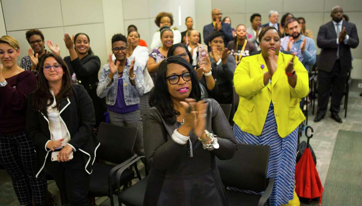 People filling the boardroom applaud for interim superintendent Grenita Lathan during a press conference at the Hattie Mae White Educational Support Center, Monday, Oct. 15, 2018 in Houston. Trustees apologized for the recent turmoil among the school board and stated that Lathan would continue to serve as the interim superintendent.