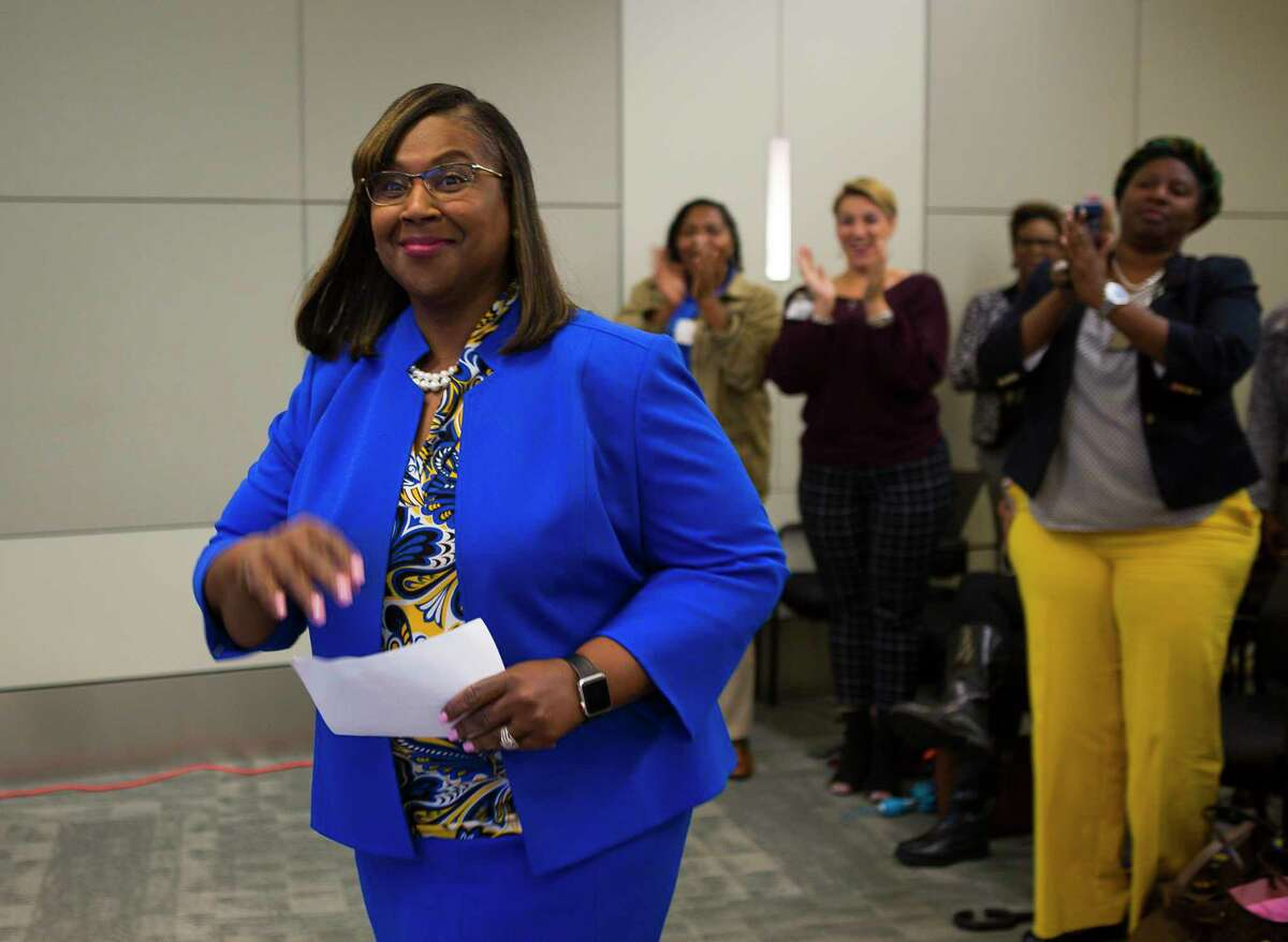 Interim superintendent Grenita Lathan is greeted by applause from a large group of supporters as she entered the Houston Independent School District school board boardroom for a press conference with the HISD trustees at the Hattie Mae White Educational Support Center, Monday, Oct. 15, 2018 in Houston. Trustees apologized for the recent turmoil among the school board and stated that Lathan would continue to serve as the interim superintendent.