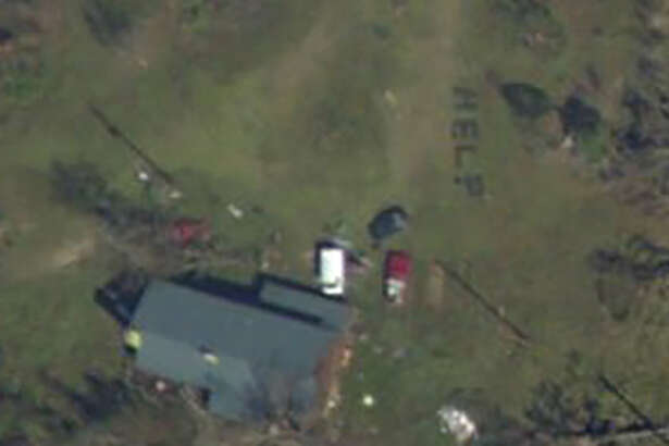 A Florida family awaiting assistance after Hurricane Michael was found after the HELP sign they made out of tree logs was photographed by an aerial team and then found by a family member.