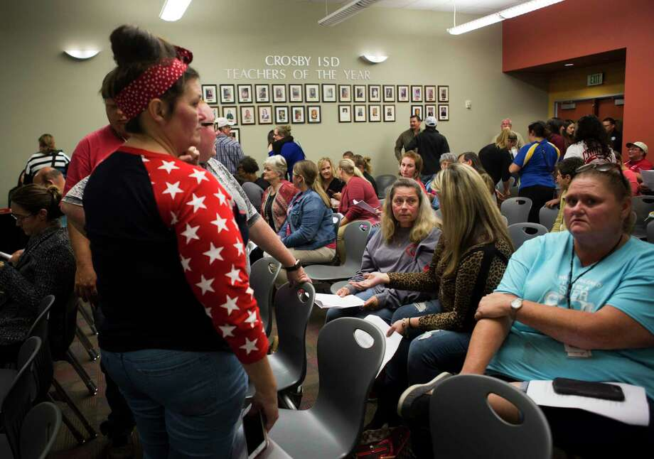 Crosby residents attend a school board meeting on Oct. 15. The district has announced that it will cut pre-K to half a day to save money. PHOTOS: Texas school districts in financial trouble Photo: Marie D. De Jesús, Staff Photographer / © 2018 Houston Chronicle