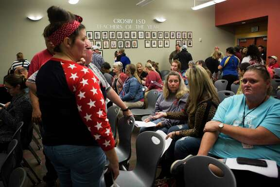 Citizens of Crosby wait for the Crosby ISD board of trustees to finish an executive session, Monday, Oct. 15, 2018, in Crosby.