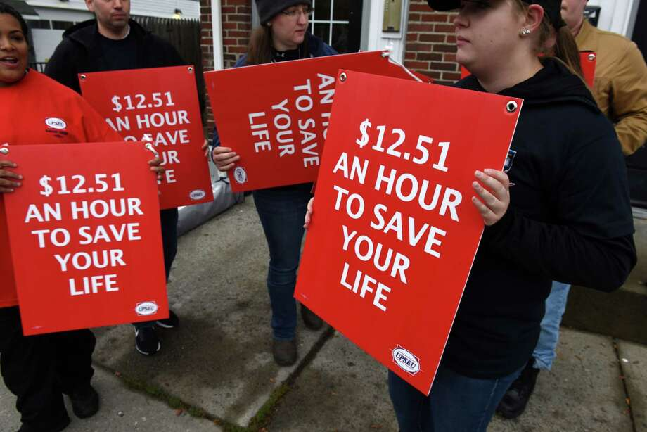 Roni Weeks, right, joined fellow Mohawk Ambulance Service workers in asking for better pay and working conditions from the local ambulance company on Monday, Oct. 15, 2018, near the Mohawk offices on Central Avenue in Albany, N.Y. The emergency medical staffers are represented by the United Professional Services Employees Union. Their contract expired in April. (Will Waldron/Times Union) Photo: Will Waldron
