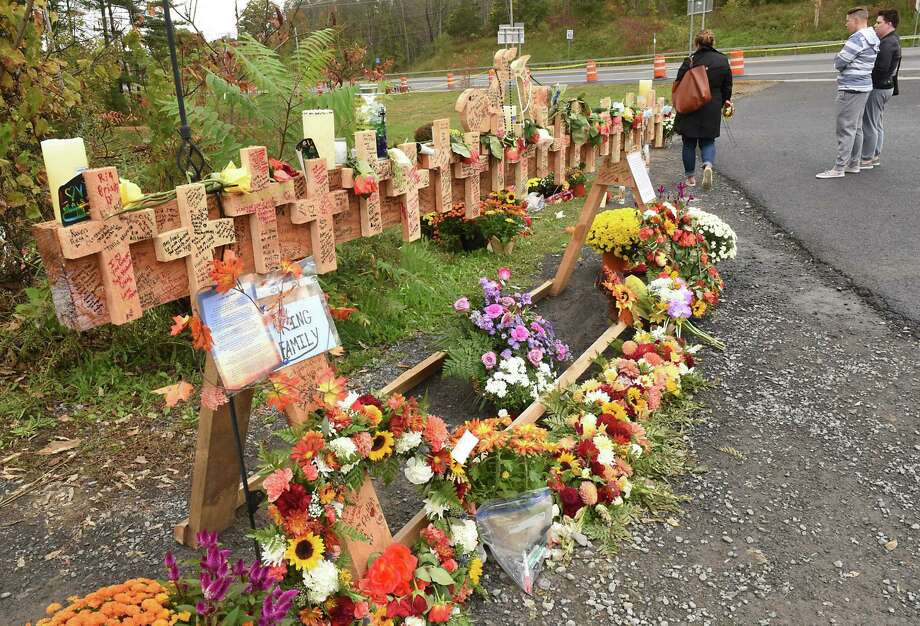 People visit a growing memorial for the Schoharie limo crash victims at the site of the accident next to the Apple Barrel Store on Monday, Oct. 15, 2018 in Schoharie, N.Y. (Lori Van Buren/Times Union) Photo: Lori Van Buren