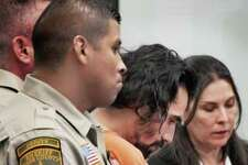 Victor Manuel Palomo is guarded by Webb County Sheriff's deputies in the 341st District Courtroom, Monday.