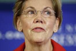 Sen. Elizabeth Warren, D-Mass., at the National Press Club in Washington on Aug. 21, 2018.